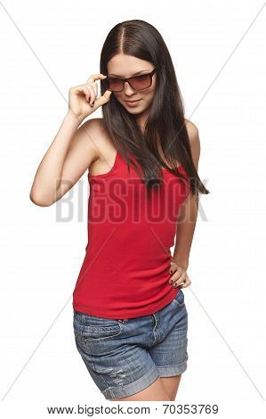 Pensive woman holding her sunglasses rim