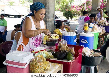 Hispanic woman sells the prepared meal