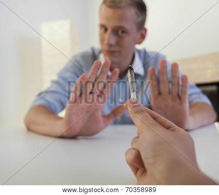 Man Refusing A Joint