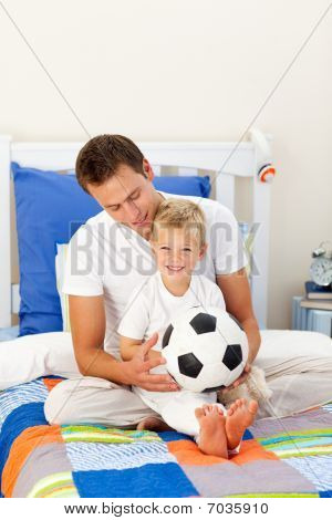 Cute Little Boy And His Father Playing With A Soccer Ball