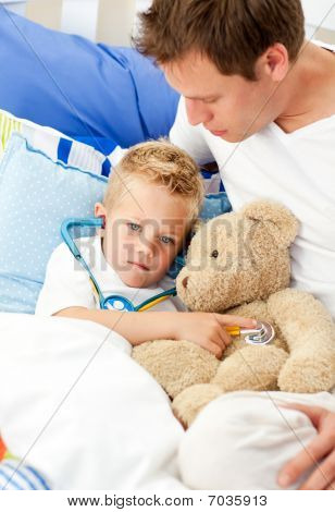 Earing Father And His Sick Son Playing With A Stethoscope