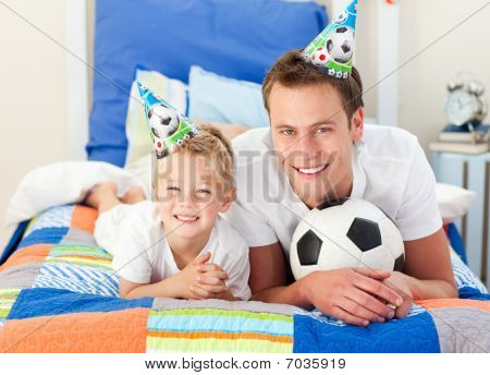Happy Child And His Father Playing With A Soccer Ball