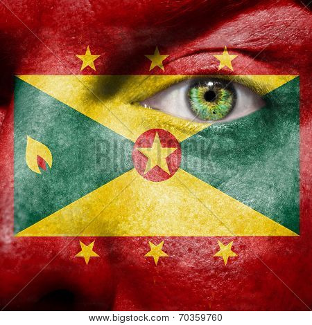 Flag Painted On Face With Green Eye To Show Grenada Support