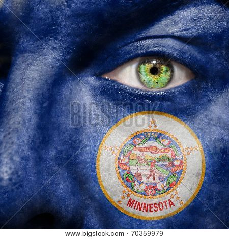 Flag Painted On Face With Green Eye To Show Minnesota Support