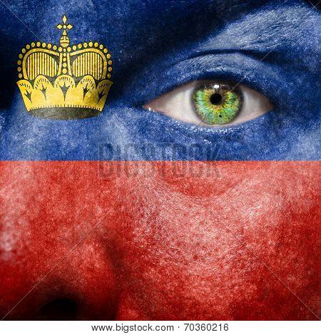 Liechtenstein Flag Painted On A Man's Face