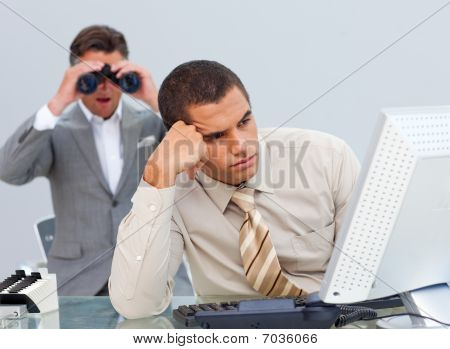 Young Businessman Getting Bored And His Manager Looking Through Binoculars