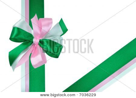 Festive Bow made of Green and Pink Ribbons Isolated