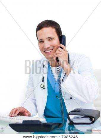 Young Doctor Talking On Phone