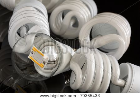 Led Bulb Between Several Cfl Lamps