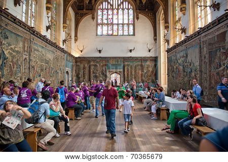 HAMPTON COURT, UK - AUGUST 03, 2014 - The Tudor Great Hall at Hampton Court Palace with group of tourists on August 03, 2014