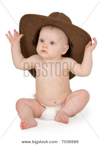Baby And Cowboy Hat On White Background