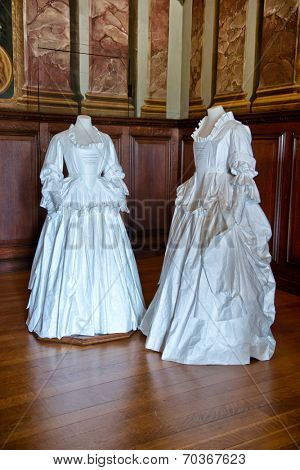 HAMPTON COURT, UK - AUGUST 03, 2014 - White baroque style clothes at Hampton Court Palace near London