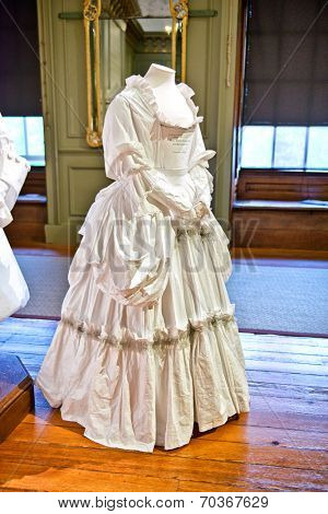 HAMPTON COURT, UK - AUGUST 03, 2014 - White baroque style female dress at Hampton Court Palace near London on August 03, 2014