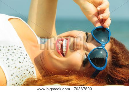 Beautiful Redhaired Girl In glasses On Beach, Portrait