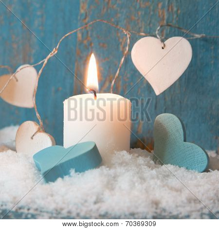 Christmas Candle In White With Blue Hearts, Wood And Snow For Decoration