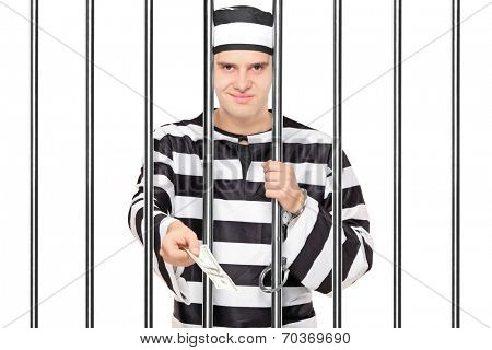 Prisoner offering bribe to someone behind bars isolated on white background
