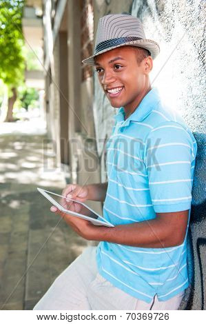 Young Attractive Male Using Tablet Pc.