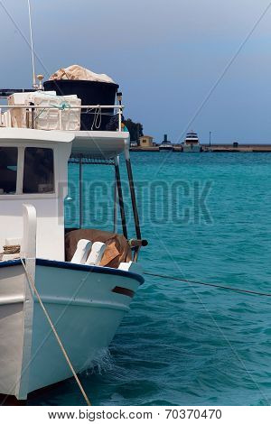 A small fishing boat tied into harbour on a beautiful sea, Zakinthos, Greece