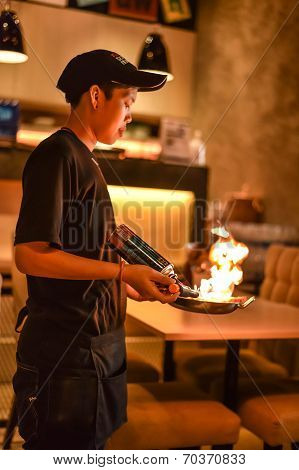Thai Chef Is Firing Fresh Grilled Seafood To Show Customers In Dark Atmosphere With Creative Style