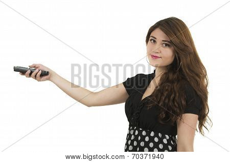 Young girl holding remote control