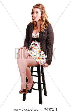 Pretty Girl On A Bar Chair.