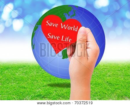 Red Paper Shape In Hand And Globe On Grass Background. Environment Concept.