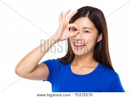 Woman with ok sign cover her eye
