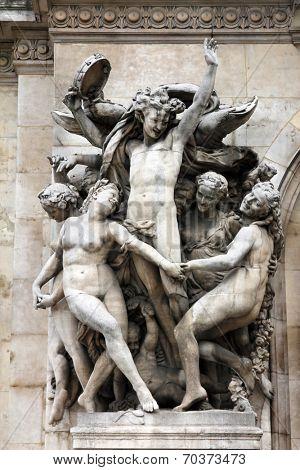 PARIS, FRANCE - NOVEMBER 08, 2012: Architectural details of Opera National de Paris: Dance Facade sculpture by Carpeaux.Grand Opera is famous neo-baroque building in Paris. UNESCO World Heritage Site.