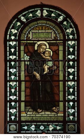 CETINJE, MONTENEGRO - JUNE 09, 2012: Saint Anthony of Padua, Stained glass in Catholic Church of St. Anthony of Padua, on June 09, 2009 in Cetinje, Montenegro
