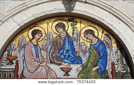 BUDVA, MONTENEGRO - JUNE 09, 2012: Mosaic over the entrance of the Holy Trinity Orthodox Church in Budva, Montenegro on June 09, 2012
