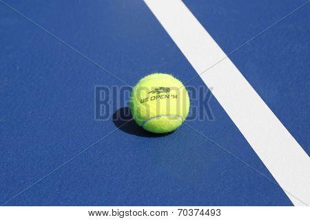 Wilson tennis ball on tennis court at Arthur Ashe Stadium