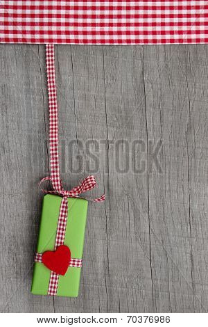 Gift For Christmas, Birthday Or Valentine With A Red Heard On A Wooden Background