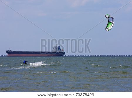 Kitesurfer and Tanker