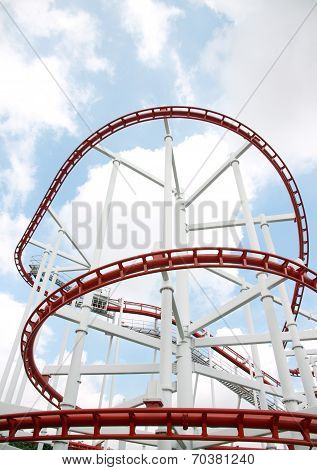 Roller Of Coaster Against Blue Sky.