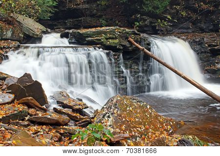 Waterfall With Autumn Leaves