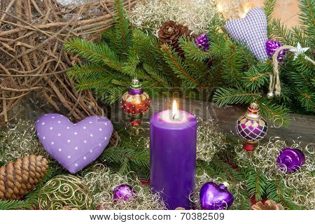 Violet Or Purple Christmas Decoration With A Candle And A Red Dotted Heart