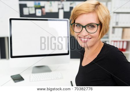 Friendly Businesswoman Working At Her Computer