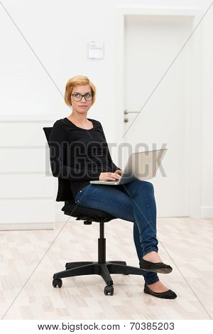 Young Businesswoman Lost In Thought