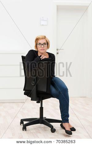 Serious Businesswoman Sitting Thinking