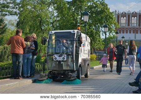 MOSCOW, RUSSIA - MAY 17, 2014: Street sweeper in the Alexander garden. About 6,000 vacuum street cleaners working in the central part of Moscow