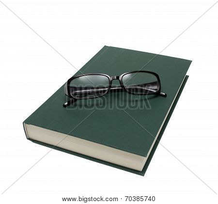 Reading Glasses On Book Isolated On White