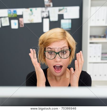 Young Businesswoman Reacting In Surprise