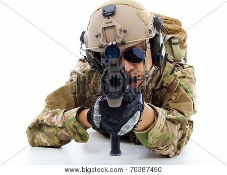 Soldier With Rifle And Lying On Floor Over White Background