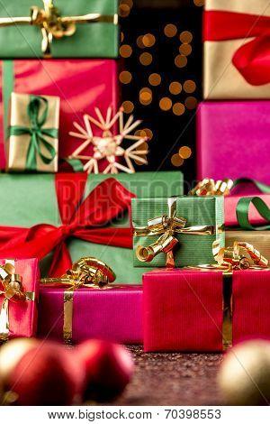 Twinkles Between Towering Xmas Gifts