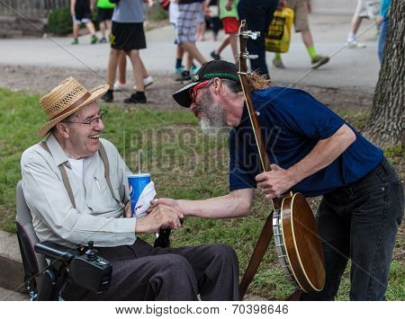 Banjo Player With Man In Wheelchair At Iowa State Fair