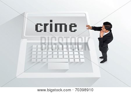 The word crime and thoughtful asian businessman pointing against white laptop