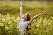 picture of rapture  - Happy young woman in a state of rapture - JPG