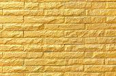 picture of brick block  - golden brick wall background pattern texture  - JPG