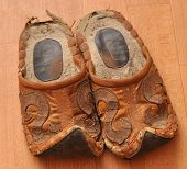 stock photo of homogeneous  - Worn pair of slippers on a homogeneous background closeup - JPG