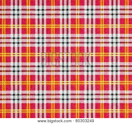 Fabric with a checked pattern in red tones